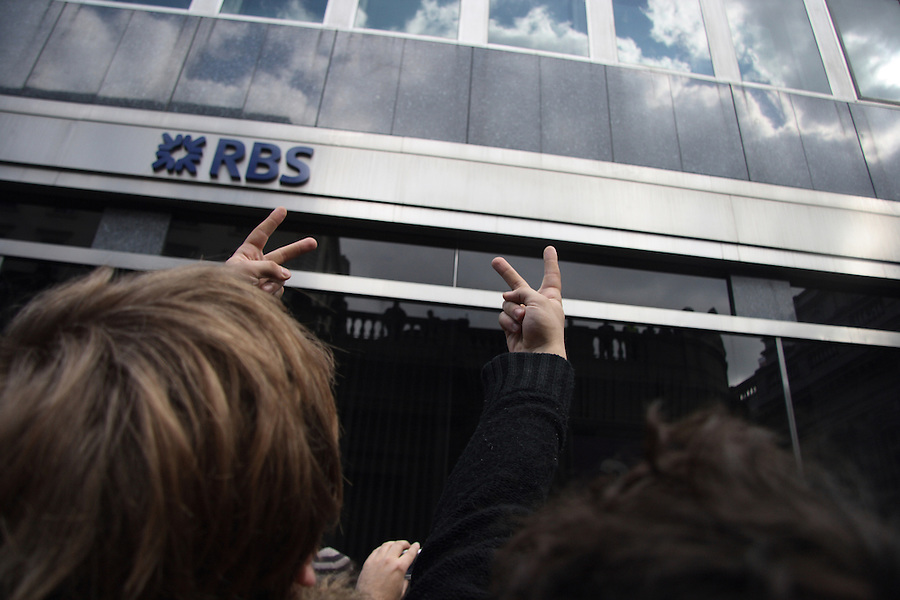 A Proster shows RBS the v-sign as the G20 Demonstration passes the bank.