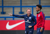 England U20 Head Coach Keith Downing chats to Chris Willock (Benfica) of England U20 ahead of the International friendly match between England U20 and Netherlands U20 at New Bucks Head, Telford, England on 31 August 2017. Photo by Andy Rowland.