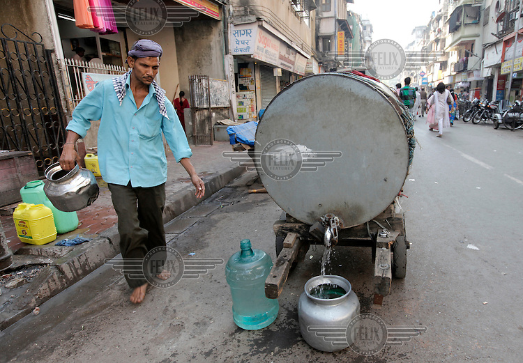 Mumbai has a water shortage. Drinking water is often distributed by carts and  lorries.