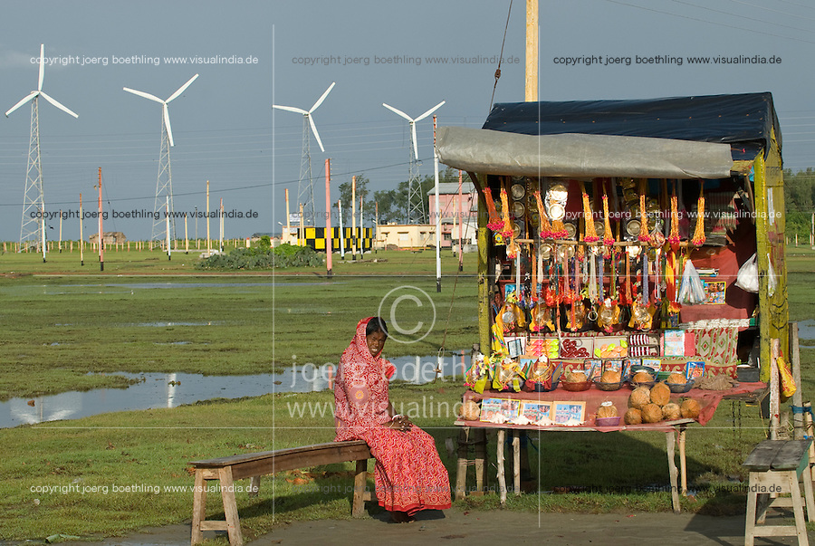 INDIA Westbengal ,  Sundarbans the delta of Ganges river , Sagar Island, shop for devotionals infront of Windfarm / INDIEN Westbengalen , Sagar Insel im Gangesdelta Sunderbans, Devotionalien Shop vor Windpark
