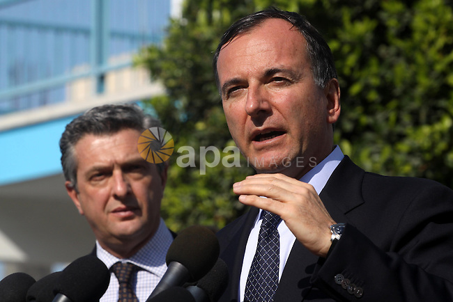 Italian Foreign Minister Franco Frattini, is accompanied by members of his delegation and security personnel during a press conference at a United Nations Relief and Works Agency (UNRWA) school in Gaza City, on 24 November 2010 . Photo by Mohammed Asad