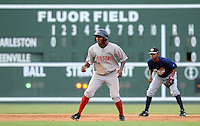 Outfielder Felix Sanchez (34) of the Greenville Drive takes a lead off second base in a game against the Charleston RiverDogs on July 31, 2011, at Fluor Field at the West End. Sanchez is wearing a throwback jersey honoring the Upstate's textile mill baseball teams on a night when the Drive celebrated Mill League Night. The throwback jerseys were auctioned off after the game. (Tom Priddy/Four Seam Images)