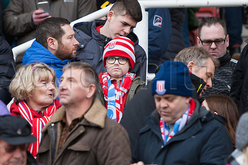 March 4th 2017,  bet365 Stadium, Stoke, England; EPL Premier League football, Stoke City versus Middlesbrough; A young Stoke fan watches the match