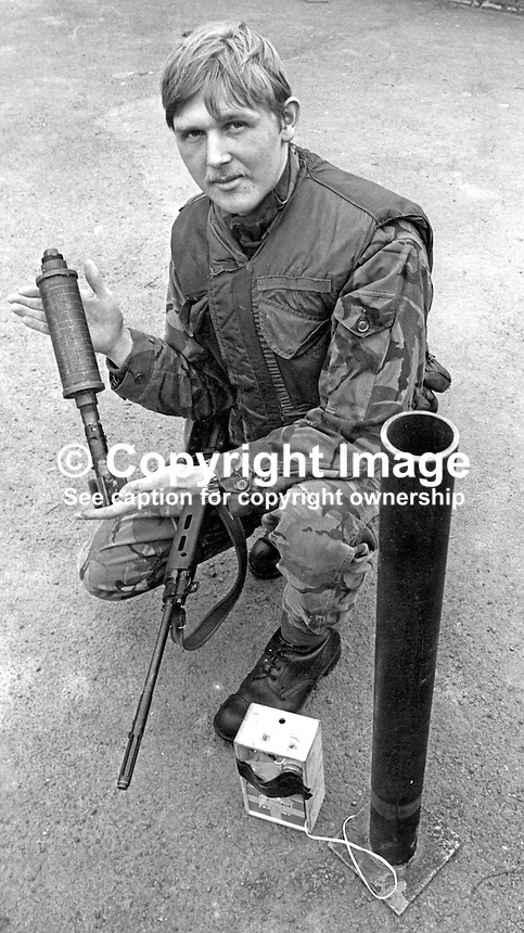Gary Walters, stationed RAF Aldergrove, N Ireland, displays the mortar launcher he discovered mounted on a lorry at the perimeter of Belfast International Airport. The airport is shared with RAF, Royal Air Force. 6th March 1976. 197603070149<br />