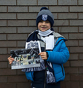 2nd December 2017, The Hawthorns, West Bromwich, England; EPL Premier League football, West Bromwich Albion versus Crystal Palace; A young West Bromwich supporter wearing his team hat and holding a match day programme