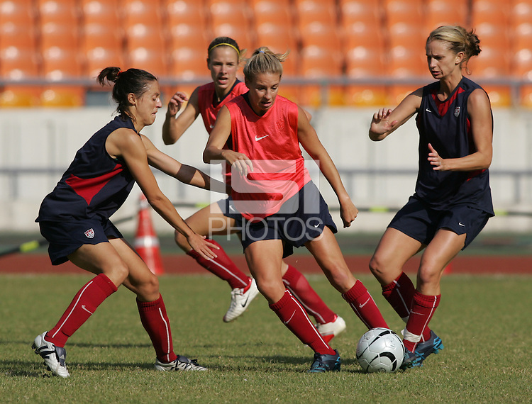 USWNT midifleder Aly Wagner tries to push between defenders Kate Markgraf (left) and Marci Miller (right) during practice for the Queen Peace Cup at Olympic Stadium in Seoul, South Korea, October 27, 2006.