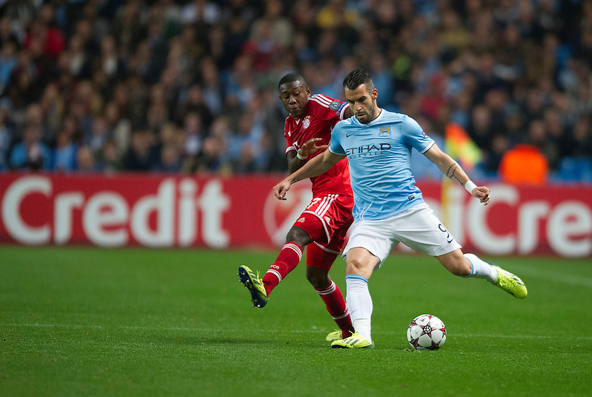 Manchester City's Alvaro Negredo shields the ball from Bayern Munich's David Alaba<br /> <br /> Photo by Stephen White/CameraSport<br /> <br /> Football - UEFA Champions League Group D - Manchester City v Bayern Munich - Wednesday 2nd October 2013 -  Etihad Stadium - Manchester<br /> <br /> &copy; CameraSport - 43 Linden Ave. Countesthorpe. Leicester. England. LE8 5PG - Tel: +44 (0) 116 277 4147 - admin@camerasport.com - www.camerasport.com