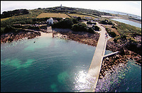 BNPS.co.uk (01202 558833)<br /> Pic: Sibleys/BNPS<br /> <br /> Scilly-Money....<br /> <br /> Britain's most south-westerly pub is looking for a new landlord and the lucky buyer can get a slice of island paradise for the &pound;795,000 price tag.<br /> <br /> The Turks Head pub is on St Agnes, one of five little islands that make up the Scilly Isles, which is just a mile-wide and has a population of only 72 people.<br /> <br /> But the remote business is hugely popular with the thousands of tourists who flock to the islands every year and makes enough money between April and October that the new owner could take five months off in the quiet season.<br /> <br /> Estate agents Sibleys say it is a unique opportunity and likely to appeal to someone looking for a lifestyle change to really embrace island living.<br /> <br /> The well-established pub is the only one on the island of St Agnes and is in the former Coastguard boathouse, with the original slipway.