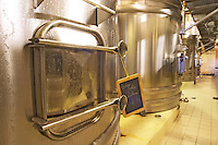 The winery with stainless steel fermentation tanks. Detail of one of the doors and a chalkboard saying blanc 04 (white wine from the 2004 vintage). The tank is wet with condensation since the wine inside is chilled Chateau Thieuley La Sauve Majeure Entre-deux-Mers Bordeaux Gironde Aquitaine France