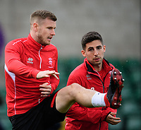 Lincoln City's Michael O'Connor, left, with team-mate Tom Pett during the pre-match warm-up<br /> <br /> Photographer Chris Vaughan/CameraSport<br /> <br /> The EFL Sky Bet League Two - Lincoln City v Crewe Alexandra - Saturday 6th October 2018 - Sincil Bank - Lincoln<br /> <br /> World Copyright &copy; 2018 CameraSport. All rights reserved. 43 Linden Ave. Countesthorpe. Leicester. England. LE8 5PG - Tel: +44 (0) 116 277 4147 - admin@camerasport.com - www.camerasport.com