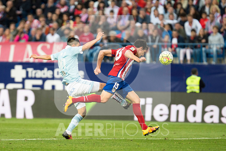 Atletico de Madrid's Savic and Celta de Vigo's Nolito during La Liga Match at Vicente Calderon Stadium in Madrid. May 14, 2016. (ALTERPHOTOS/BorjaB.Hojas)