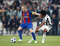 Football Soccer: UEFA Champions UEFA Champions League quarter final first leg Juventus-Barcellona, Juventus stadium, Turin, Italy, April 11, 2017. <br /> Barcellona's Andr&eacute;s iniesta (l) in action with Juventus Juan Cuadrado (r) during the Uefa Champions League football match between Juventus and Barcelona at the Juventus stadium, on April 11 ,2017.<br /> UPDATE IMAGES PRESS/Isabella Bonotto