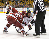 Alex Fallstrom (Harvard - 16), Mike McLaughlin (Northeastern - 18) - The Harvard University Crimson defeated the Northeastern University Huskies 3-2 in the 2012 Beanpot consolation game on Monday, February 13, 2012, at TD Garden in Boston, Massachusetts.