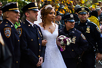 NEW YORK, USA - November 11: NYPD officers get married as they attend the 100 Veterans Day parade on November 11, 2019 in New York, USA. President Donald Trump, the first sitting U.S. president attended New York's parade, where he offered a tribute to veterans ahead of the 100th annual parade  (Photo by Eduardo MunozAlvarez/VIEWpress)