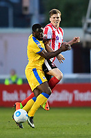 Lincoln City's Sean Raggett vies for possession with Chester's James Alabi<br /> <br /> Photographer Chris Vaughan/CameraSport<br /> <br /> Vanarama National League - Lincoln City v Chester - Tuesday 11th April 2017 - Sincil Bank - Lincoln<br /> <br /> World Copyright &copy; 2017 CameraSport. All rights reserved. 43 Linden Ave. Countesthorpe. Leicester. England. LE8 5PG - Tel: +44 (0) 116 277 4147 - admin@camerasport.com - www.camerasport.com