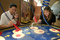 Family palying with a bubble machine at Universeum Science center.