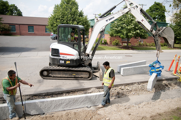 TORRINGTON, CT - 06 JUNE 2014 -- A crew from Torrington-based Greenstone Landscaping installs new granite curbing along what will be a new sidewalk near the Torrington Armory on Coe Place Tuesday. The city is embarking on a master plan for its sidewalks that will guide future repairs throughout the city.  Alec Johnson/ Republican-American