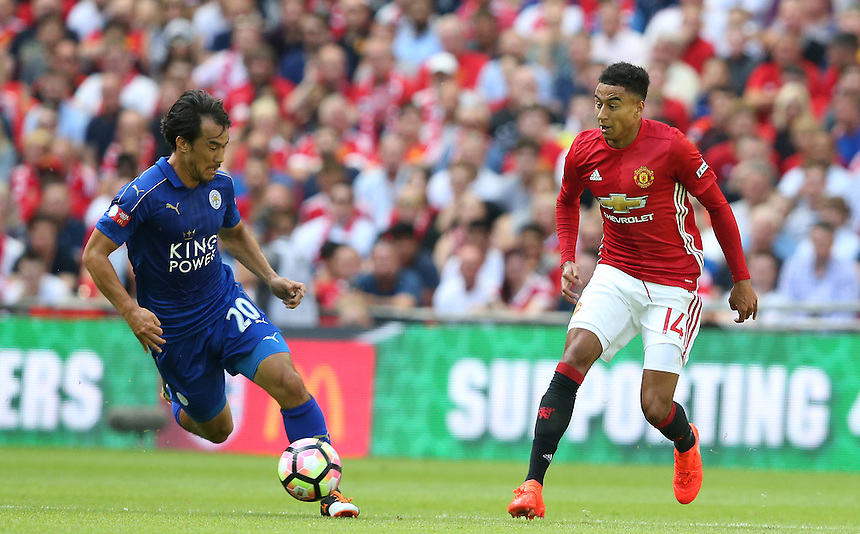 Leicester City's Shinji Okazaki and Manchester United's Jesse Lingard<br /> <br /> Photographer Stephen White/CameraSport<br /> <br /> Football - The FA Community Shield - Leicester City v Manchester United - Sunday 7 August 2016 - Wembley Stadium - London<br /> <br /> World Copyright &copy; 2016 CameraSport. All rights reserved. 43 Linden Ave. Countesthorpe. Leicester. England. LE8 5PG - Tel: +44 (0) 116 277 4147 - admin@camerasport.com - www.camerasport.com