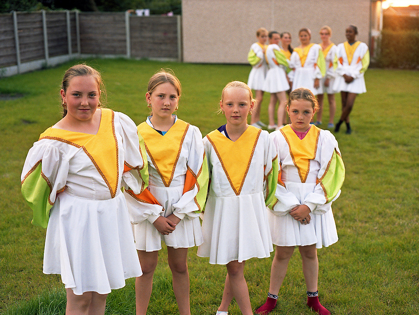 HATTERSLEY, UK - Members of Hattersley Youth Morris Dancers wear outfits designed and hand-made by parents on the Hattersley Estate.. .The Hattersley Estate was created in the early 1960s to house residents displaced by the slum clearances of inner city Salford and Manchester and soon gained notoreity between 1963 and 1965 as the home to the Moors Murderers, Myra Hindley and Ian Brady. Lying in a relatively isolated area on the edge of the Pennines, residents today continue to wait for the investment and infrastructure promised to them decades ago. In the gap between promise and reality, a unique characted formed during years of adversity continues to thrive on the estate.