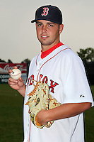 Lowell Spinners pitcher Garrett Rau (6) poses for a photo in a Boston Red Sox uniform during a rain delay at Falcon Park in Auburn, New York August 9, 2010.  Rau was selected in the 2010 MLB Draft by the Red Sox in the 12th round (383rd overall) out of California Baptist (CA).  The game between the Lowell Spinners and Auburn Doubledays was cancelled due to rain.  Photo By Mike Janes/Four Seam Images