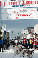 Cim Smyth and team leave the ceremonial start line with an Iditarider at 4th Avenue and D Street in downtown Anchorage, Alaska on Saturday, March 5th during the 2016 Iditarod race. Photo by Joshua Borough/SchultzPhoto.com