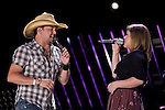 Jason Aldean performs with Kelly Clarkson at LP Field during the 2011 CMA Music Festival on June 9, 2011 in Nashville, Tennessee.
