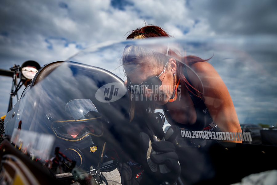 Apr 22, 2017; Baytown, TX, USA; NHRA top fuel driver Scott Palmer talks with crew chief Ashley Fye during qualifying for the Springnationals at Royal Purple Raceway. Mandatory Credit: Mark J. Rebilas-USA TODAY Sports