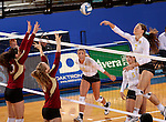 BROOKINGS, SD - OCTOBER 3:  Moni Corrujedo #10 and Sarah Schmid #3 from Denver look to block a kill attempt by Tiara Gibson #7 from South Dakota State University in the first game of their match Friday night at Frost Arena. (Photo/Dave Eggen/Inertia)
