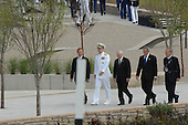 Arlington, VA - September 11, 2008 -- The official party walks back to the dais as the United States Air Force Band plays at the Pentagon Memorial dedication ceremony Sept. 11, 2008. The national memorial is the first to be dedicated to those killed at the Pentagon on Sept. 11, 2001. The site contains 184 inscribed memorial units honoring the 59 people aboard American Airlines Flight 77 and the 125 in the building who lost their lives that day. .Credit: Adam Stump - DoD via CNP.Credit: DoD via CNP
