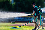 24 August 2019: Vermont Lake Monsters Groundskeeper waters down the infield prior to a game against the Lowell Spinners at Centennial Field in Burlington, Vermont. The Lake Monsters fell to the Spinners 3-2 in NY Penn League action. Mandatory Credit: Ed Wolfstein Photo *** RAW (NEF) Image File Available ***
