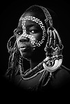 Young Boy wearing head gear, Mursi Tribe, Mago National Park, Lower Omo Valley, Ethiopia, portrait, person, one, tribes, tribal, indigenous, peoples, Southern, ethnic, rural, local, traditional, culture, primitive,.Africa....