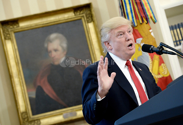 United States President Donald Trump speaks about  trade in the Oval Office of the White House, March 31, 2017 in Washington, DC. <br /> Credit: Olivier Douliery / Pool via CNP /MediaPunch