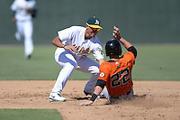 Oakland Athletics infielder Edwin Diaz (29) tags out Christian Arroyo (22) sliding into second during an instructional league game against the San Francisco Giants on September 27, 2013 at Papago Park Baseball Complex in Phoenix, Arizona.  (Mike Janes/Four Seam Images)