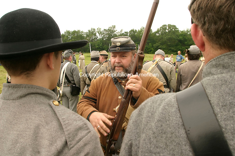GOSHEN, CT--17 JUNE 2006 -061706JS24- Confederate soldiers have their weapons checked during the Civil War encampment in Goshen. The reenactment depicts the Jackson Valley Campaign.  -- Jim Shannon Republican-American