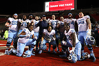 RALEIGH, NC - NOVEMBER 30: University of North Carolina offensive line players Ty Murray #55, Joshua Ezeudu #75, Marcus McKethan #73, Brian Anderson #68, Charlie Heck #67, Nick Polino #58, Jordan Tucker #74, #Billy Ross #56, William Barnes #76, Quiron Johnson #69, Asim Richards #72, and Offensive Line Coach Stacy Searels pose for a photo during a game between North Carolina and North Carolina State at Carter-Finley Stadium on November 30, 2019 in Raleigh, North Carolina.