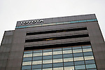 A Toyota Motor Corporation (TMC) signboard on display outside its headquarters building where Takahiko Ijichi Executive Vice President reported company's 6-month financial results during a press conference on November 8, 2016, in Tokyo, Japan. Ijichi said that despite cost reduction and marketing efforts, operating income dropped by 466.5 billion yen compared to the first half of the last fiscal year mainly as a result of currency fluctuations. Toyota reported a total of 4,363,537 vehicles sold worldwide for the period April-September 2016, up 85,530 units compared to the same period in the previous year.(Photo by Rodrigo Reyes Marin/AFLO)