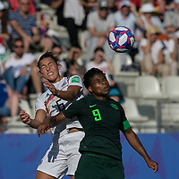 GRENOBLE, FRANCE - JUNE 22: Lena Oberdorf #6 of the German National Team, Desire Oparanozie #9 of the Nigerian National Team battle for head ball during a game between Nigeria and Germany at Stade des Alpes on June 22, 2019 in Grenoble, France.