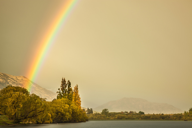A spectacular rainbow over Lake Hayes, Queenstown New Zealand - stock image, fine art, canvas print