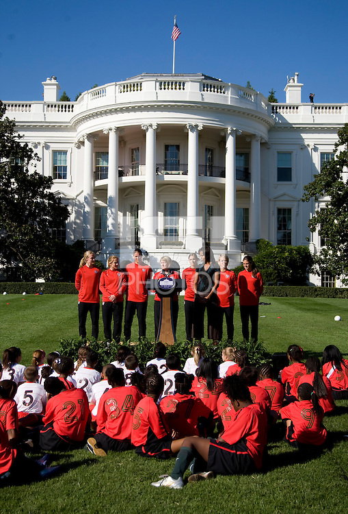 USWNT general manager Cheryl Bailey talks to a crowd of young players during a Lets Move! soccer clinic held on the South Lawn of the White House.  Let's Move! was started by Mrs. Obama as a way to promote a healthier lifestyle in children across the country.