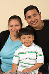 preschool age boy 4 or 5 years old portrait with mother and father vertical