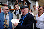 12-6-07 Killarney: Brandishing the Taosieach signed document worth millions of euro to South Kerry, Deputy Jackie Healy-Rae proudly fulfills his promise to his constituents in Killarney on Tuesday.<br /> Picture by Don MacMonagle