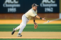 Wake Forest Demon Deacons shortstop Pat Blair (11) flips the ball to second base during the game against the North Carolina State Wolfpack at Wake Forest Baseball Park on March 15, 2013 in Winston-Salem, North Carolina.  The Wolfpack defeated the Demon Deacons 12-6.  (Brian Westerholt/Four Seam Images)