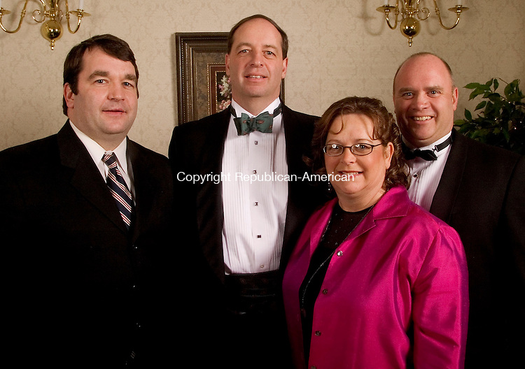 SOUTHINGTON, CT- 05 FEBRUARY 2005-020505JS14--Children of former Saint Mary's board member Harold F. Sullivan, from left, Neil F. Sullivan; Wayne F. Sullivan; Lois Sullivan and Keith F. Sullivan at the Saint Mary's Hospital Foundation's 14th annual gala Saturday at the Aqua Turf in Southington. The theme for this year's event was 'Young at Heart' with procedes to benefit Saint Mary's advanced cardiac care program.  -- Jim Shannon Photo--Aqua Turf; Saint Mary's Hospital; Harold F. Sullivan; Neil F. Sullivan; Wayne F. Sullivan; Lois Sullivan; Keith F. Sullivan are CQ