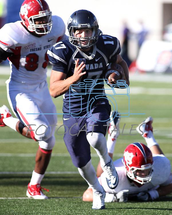 Nevada quarterback Cody Fajardo runs for a touchdown in the fourth quarter against Fresno State defender Tristan Okpalaugo (88) during an NCAA football game in Reno, Nev., on Saturday, Oct. 21, 2011. Nevada won 45-38. (AP Photo/Cathleen Allison)