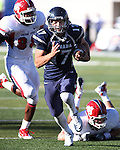 Nevada quarterback Cody Fajardo runs for a touchdown in the fourth quarter against Fresno State defender Tristan Okpalaugo (88) during an NCAA football game in Reno, Nev., on Saturday, Oct. 21, 2011. Nevada won 45-38. (AP Photo/Cathleen Allison)