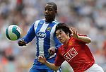 Titus Bramble of Wigan Athletic and Ji-Sung Park of Manchester United during the Premier League match at The JJB Stadium, Wigan. Picture date 11th May 2008. Picture credit should read: Simon Bellis/Sportimage