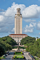 UT Tower Vertical 3 - This is the UT Tower taken from the south side with the Littlefield Fountain in view with nice puffy clouds and blue sky. The University of Texas towers is 307 feet tall and can be seen from many locations through out the city. It has become a part of the Austin cityscape. The UT Tower is a landmark for all as it can be seen from many locations throughout the city. Toursits and local have been comming to see this historical tower in downtown part of the city.