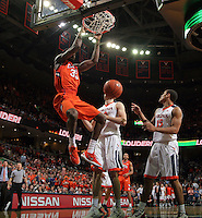 Clemson center Landry Nnoko (35) dunks the ball in front of Virginia center Mike Tobey (10) and Virginia guard Malcolm Brogdon (15) during an ACC basketball game Tuesday Jan. 19, 2016, in Charlottesville, Va. Virginia  defeated Clemson  69-62. (Photo/Andrew Shurtleff)