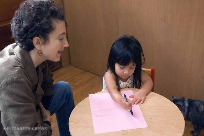 Berkeley CA Girl, two and a half, Guatemalan, and adoptive mother supervising daughter's attempts at writing MR