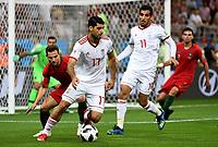 SARANSK - RUSIA, 25-06-2018: Mehdi TAREMI (Der) jugador de RI de Irán disputa el balón con CEDRIC (Izq) jugador de Portugal durante partido de la primera fase, Grupo B, por la Copa Mundial de la FIFA Rusia 2018 jugado en el estadio Mordovia Arena en Saransk, Rusia. / Mehdi TAREMI (R) player of IR Iran fights the ball with CEDRIC (L) player of Portugal during match of the first phase, Group B, for the FIFA World Cup Russia 2018 played at Mordovia Arena stadium in Saransk, Russia. Photo: VizzorImage / Julian Medina / Cont